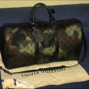 Authentic Louis Vuitton monogramouflage keepall 50